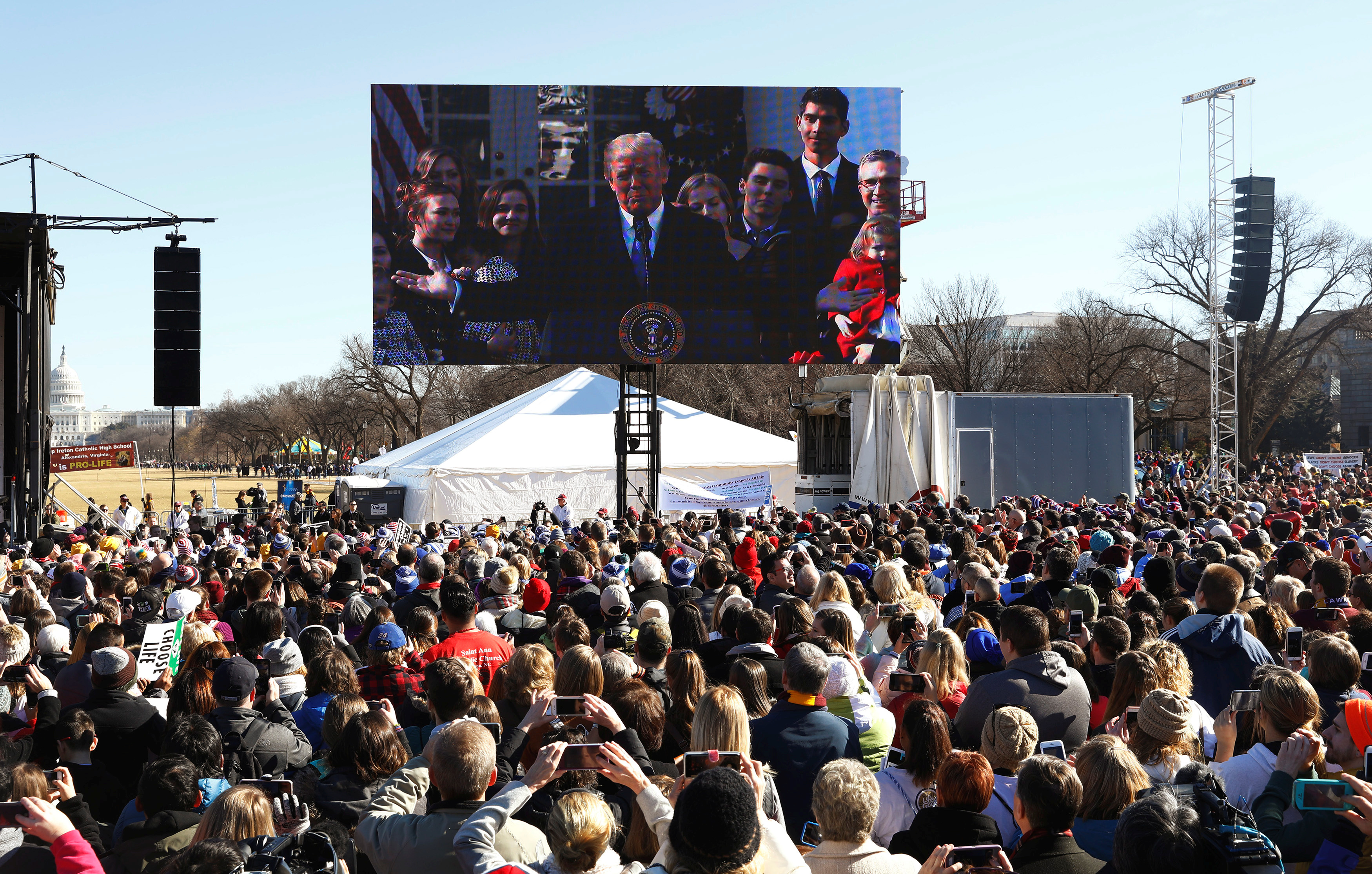 U.S. President Donald Trump, speaking from the nearby White House, addresses attendees of the March for Life rally by satellite in Washington, U.S. January 19, 2018. REUTERS/Eric Thayer