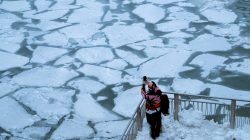 A pedestrian stops to take a photo by Chicago River, as bitter cold phenomenon called the polar vortex has descended on much of the central and eastern United States, in Chicago, Illinois, U.S., January 29, 2019. REUTERS/Pinar Istek
