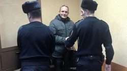 FILE PHOTO: Dennis Christensen, a Jehovah's Witness accused of extremism, leaves after a court session in handcuffs in the town of Oryol, Russia January 14, 2019. REUTERS/Andrew Osborn/File Photo
