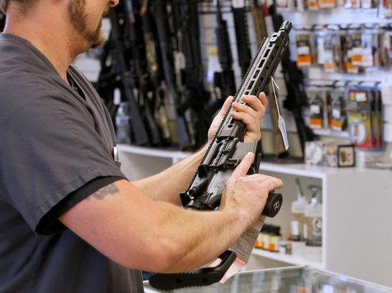 """FILE PHOTO: A prospective buyer examines an AR-15 at the """"Ready Gunner"""" gun store In Provo, Utah, U.S. in Provo, Utah, U.S., June 21, 2016. REUTERS/George Frey/File Photo"""